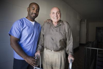 caregiver assisting senior man